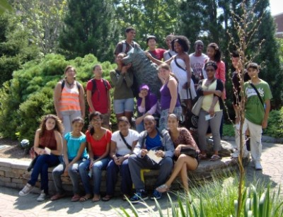 Travelers EDGE students with Husky Dog